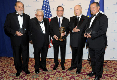 Rabbi Arthur Schneier, (2nd from right) the president and founder of the Appeal of Conscience Foundation and former United States Secretary of State, Dr. Henry Kissinger (2nd from left) present the 2016 World Statesman Award to French President, Francois Hollande (center). Mexican business magnate, investor, and philanthropist, Carlos Slim Helu (far left) and Andrew N. Liveris, the Chairman and Chief Executive Officer of The Dow Chemical Company (far right) received the 2016 Appeal of Conscience Awards at the 51st Annual Appeal of Conscience Awards Dinner held at the Waldorf Astoria in New York.