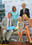 Hall of Fame pitcher Tom Glavine and his wife Chris were honored by Aflac today with the 2014 Duckprints Award for their contributions to the fight against childhood cancer. Joining them were 11 year-old Aflac Cancer Center patient Esme Miller, the Aflac Duck, and Aflac CEO Dan Amos and Aflac Foundation President Kathelen Amos. (PRNewsFoto/Aflac)