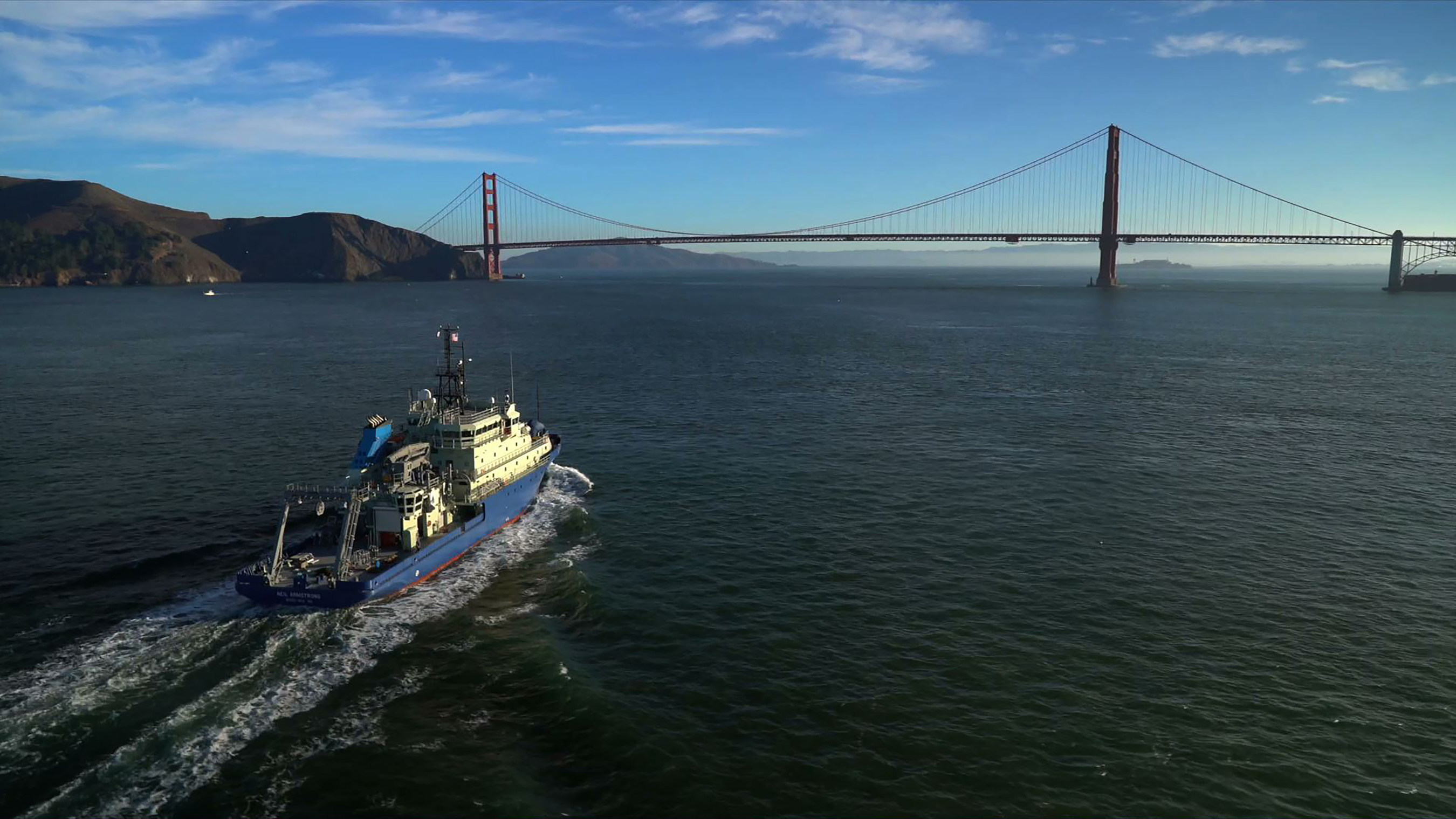 R/V Neil Armstrong approaches the Golden Gate Bridge on November 7, 2015, during the ship's maiden voyage from Anacortes, Wash. (Photo by Bay Aerial, (C)Woods Hole Oceanographic Institution)