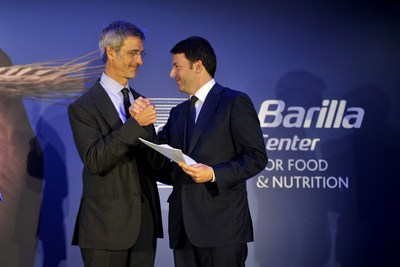 Italian Prime Minister Matteo Renzi and Barilla Center for Food and Nutrition President Guido Barilla demonstrate their support for the Milan Protocol, which aims to raise awareness for challenges facing the global food system, including: the reduction of food waste, the promotion of sustainable agriculture, and the war on hunger and obesity.