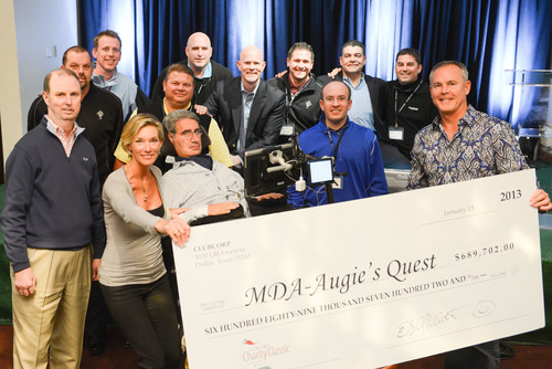 Eric Affeldt (far right), ClubCorp president and CEO, presents Lynn and Augie Nieto (front row, second and third from left) with a check for $689,702 for MDA's Augie's Quest. The donation represents a portion of the monies raised during the 2012 ClubCorp Charity Classic, which also benefits the ClubCorp Employee Partners Care Foundation and dozens of local charities throughout the United States. Also pictured, several general managers from clubs raising record amounts during their 2012 ClubCorp Charity Classic events.  ...