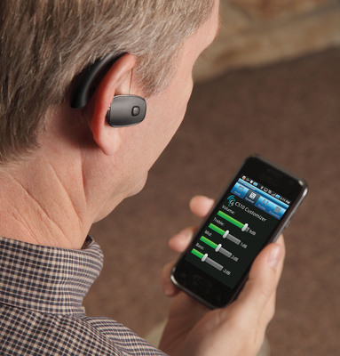 The new CS10 Personal Sound Amplifier from Sound World Solutions pictured here with free smartphone app for customization and control. The CS10 is designed for consumers who don't need a hearing aid but could use occasional assistance in hearing, particularly in difficult listening situations or environments.  (PRNewsFoto/Sound World Solutions)