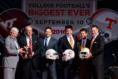 (From left): Virginia Tech's Head Coach, Frank Beamer, and Athletic Director, Jim Weaver, Bristol Motor Speedway's President and COO, Marcus Smith, and General Manager, Jerry Caldwell, and University of Tennessee's Vice Chancellor and Director of Athletics, Dave Hart, and Head Coach, Butch Jones, pose with helmets during the official announcement of the Battle at Bristol; College Football's Biggest EVER on October 14, 2013. The game is projected to set the NCAA record for highest single game attendance and will take place at Bristol Motor Speedway in 2016. www.BattleAtBristol.com. (PRNewsFoto/Bristol Motor Speedway)