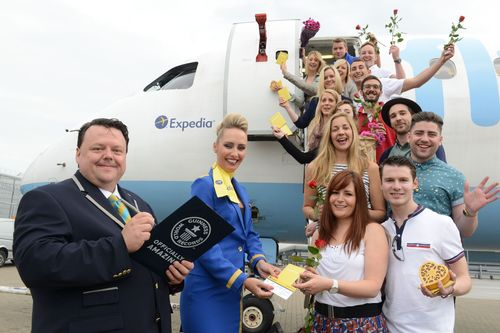 Love is in the air: it would seem the sky is not the limit for singletons as they set a new Guinness World Record for the World's Highest Speed Date. A total of 60 daters from the UK, Germany, France and Ireland had 21 three minute dates at 35,000ft on a flight from Luton to the romantic city of Venice. The new record was part of the Expedia Holidate, a dating experiment to understand how travel affects your dating experience. They are pictured with editor in chief of Guinness World Records, Craig Glenday. (PRNewsFoto/Expedia)