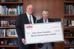 "Chester Brandes (R), President  & CEO of Imperial Brands, Inc., presents David Coker (L), President of Fisher House Foundation, with funds generated by Sobieski Vodka's ""Save & Donate"" program. (PRNewsFoto/Sobieski Vodka)"