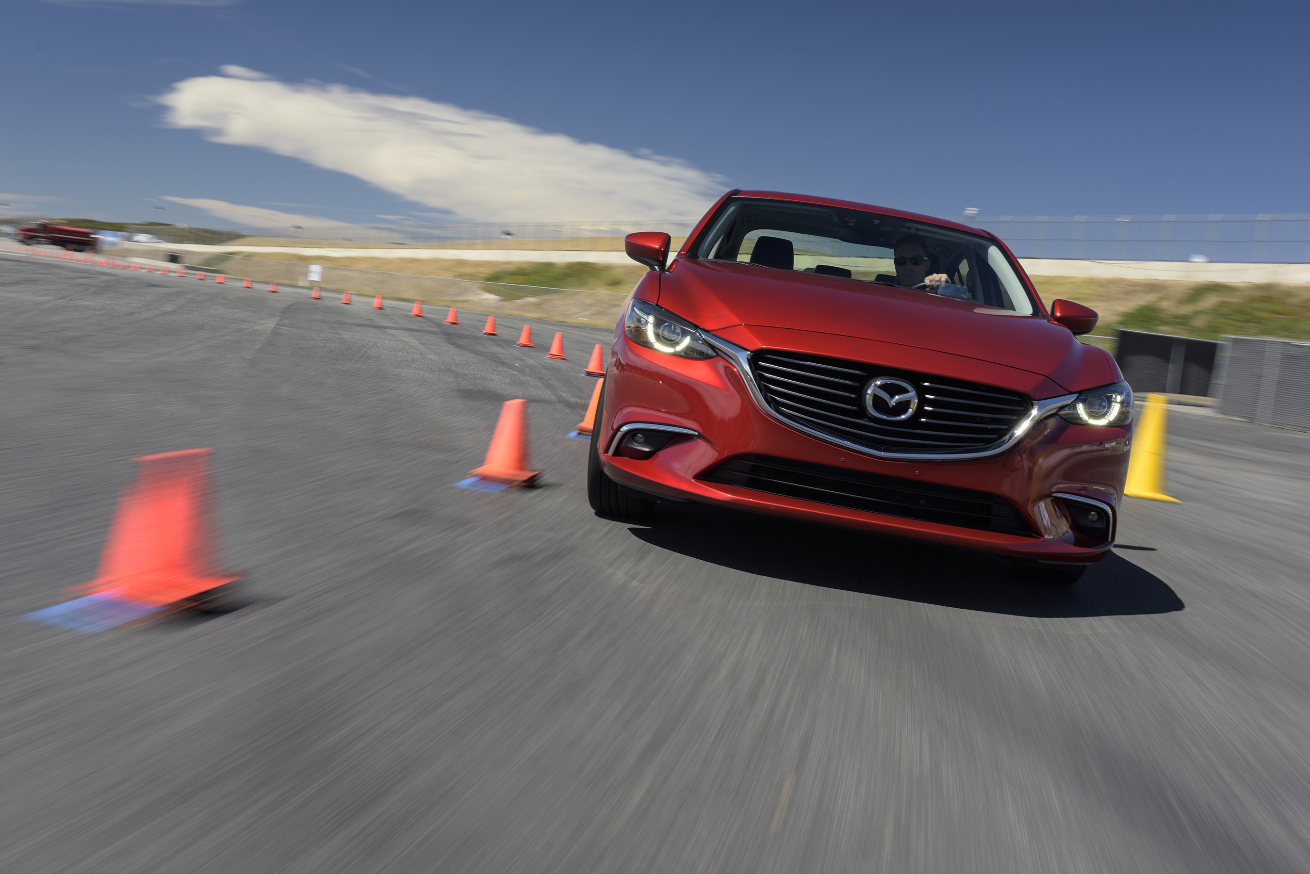 Mazda6 prototype equipped with G-Vectoring Control rounds cones at recent media event in Monterey, California.