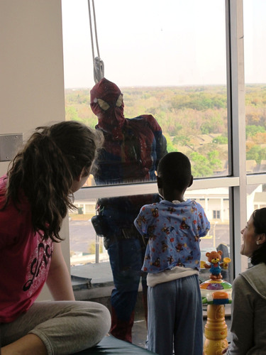 Dressed as Spider-Man, window washer Rob Powers fights grime while bringing smiles to young patients at St. ...