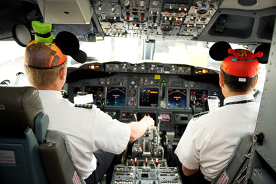 "Alaska Airlines pilots Rob Abrom and Andrew Blank prepare the ""Adventure of Disneyland Resort"" for its inaugural flight to Orange County, Calif. (PRNewsFoto/Alaska Airlines) (PRNewsFoto/ALASKA AIRLINES)"