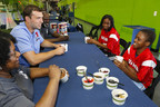 "Indianapolis Colts quarterback Andrew Luck, second from left, enjoys an oatmeal breakfast with a local Philadelphia family, the Loftons, winners of the national Quaker ""Make the Play"" contest aimed at inspiring families to get out and play together on Saturday, April 18, 2015, in Hatboro, Pa."