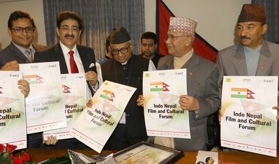 (L-R) Mr. Vipin Gaur, Editor, Country and Politics National weekly Newspaper, Mr. Sandeep Marwah, President, Marwah Studio, H.E. Mr. Deep Kumar Upadhyay, Ambassador of Nepal to the Republic of India, HE Khadga Prasad Sharma Oli, Prime Minister of Nepal