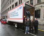 Driving Up Winter Coat Donations: New car dealers deliver over 3,000 coats to support New York Cares 2014 Winter Coat Drive. (L to r) Brian Miller, owner of Manhattan Motorcars; New York Cares executive director Gary Bagley and Bob Vail, chairman of the Greater New York Automobile Dealers Association with a truck full of coats at New York Cares distribution center at West 31st in Manhattan.