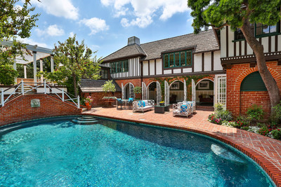One of the most admired homes in Little Holmby, a rustic half-timbered English Country estate designed in 1932 by celebrity architect Paul Revere Williams, has been listed by Aaron Kirman, president of Aaroe Estates, the luxury properties division of residential brokerage John Aaroe Group, and Aaroe Estates agent Allen Roth. The home, located at 200 Loring Avenue in Los Angeles, is offered at $8,000,000.