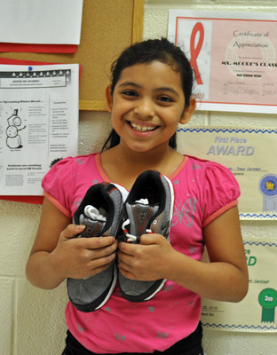 Nordstrom is partnering with New Balance, Shoes That Fit.org and Nordstrom customers to give new shoes to 10,000 kids in need.  (PRNewsFoto/Nordstrom, Inc.)