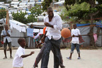 NBA legend Dikembe Mutombo visits UNICEF programs in Haiti. Photo Credit: Fritz (Fito) Dambreville.  (PRNewsFoto/U.S. Fund for UNICEF, Fritz (Fito) Dambreville)