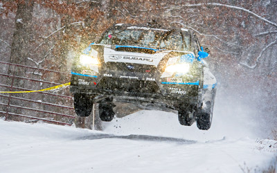 Defending Rally America Champion David Higgins powered through treacherous conditions to win Rally in the 100 Acre Wood.