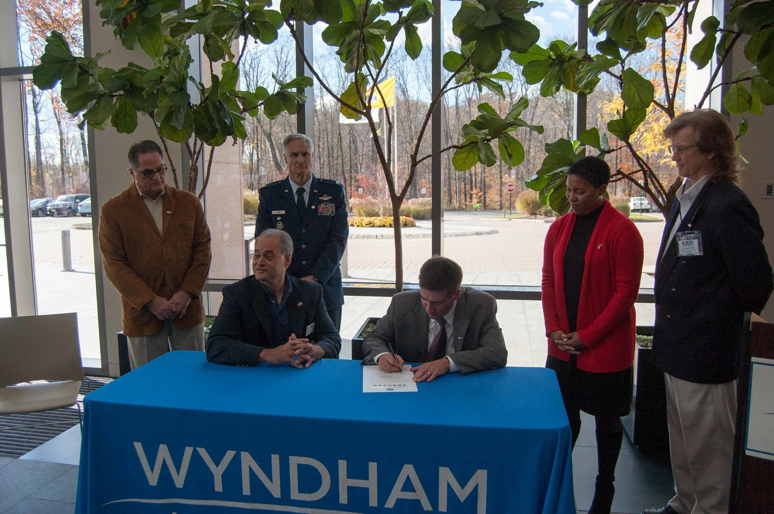Wyndham Worldwide associates and representatives of the Employer Support of the Guard and Reserve (ESGR) gather as Wyndham Worldwide signs the ESGR Statement of Support in Parsippany, N.J. on November 11, 2016.