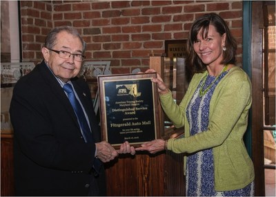 Jack Fitzgerald accepts Maryland American Trauma Society's Distinguished Service Award for 2016 for Fitzgerald Auto Malls from Susanne Ogaitis Jones