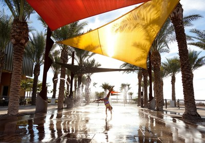The community splash pad at Eastmark is a popular amenity in this Arizona neighborhood. A community pool will be opening to Eastmark residents in 2016.