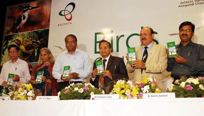 Principal Chief Conservative of Forest, G V Sugur releases a book `Birds of Hampi' authored by Samad Kottur (right) at a function in Bangalore on Saturday, 5th April 2014. Also seen are CMD, MSPL, Narendrakumar A Baldota, Director, Bombay Natural History Society, Dr Asad R Rahmani, Convener-INTACH, Hampi-Anegundi Chapter, Shama Pawar and others (PRNewsFoto/MSPL Limited)