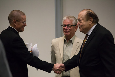 Chancellor Bernard Luskin (right) greets VCCCD Trustees Stephen Blum (left) and Bernardo Perez (center)