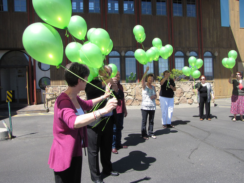 Families of organ and tissue donors release balloons in remembrance of their loved ones at the Wyoming Donor ...