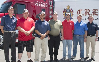 C.R. England adds six new trucks to its Honored Veterans military-themed Fleet. (Left to Right) Drivers: Darryl Wright, Josh Smith, Hardrick Crawford, Chris Yates, Jeremy Jellison, Steve Calder; C.R. England Chairman Dan England