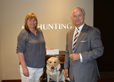 Hunting PLC Donates $135,000 To Patriot PAWS Service Dogs (PRNewsFoto/Hunting PLC)