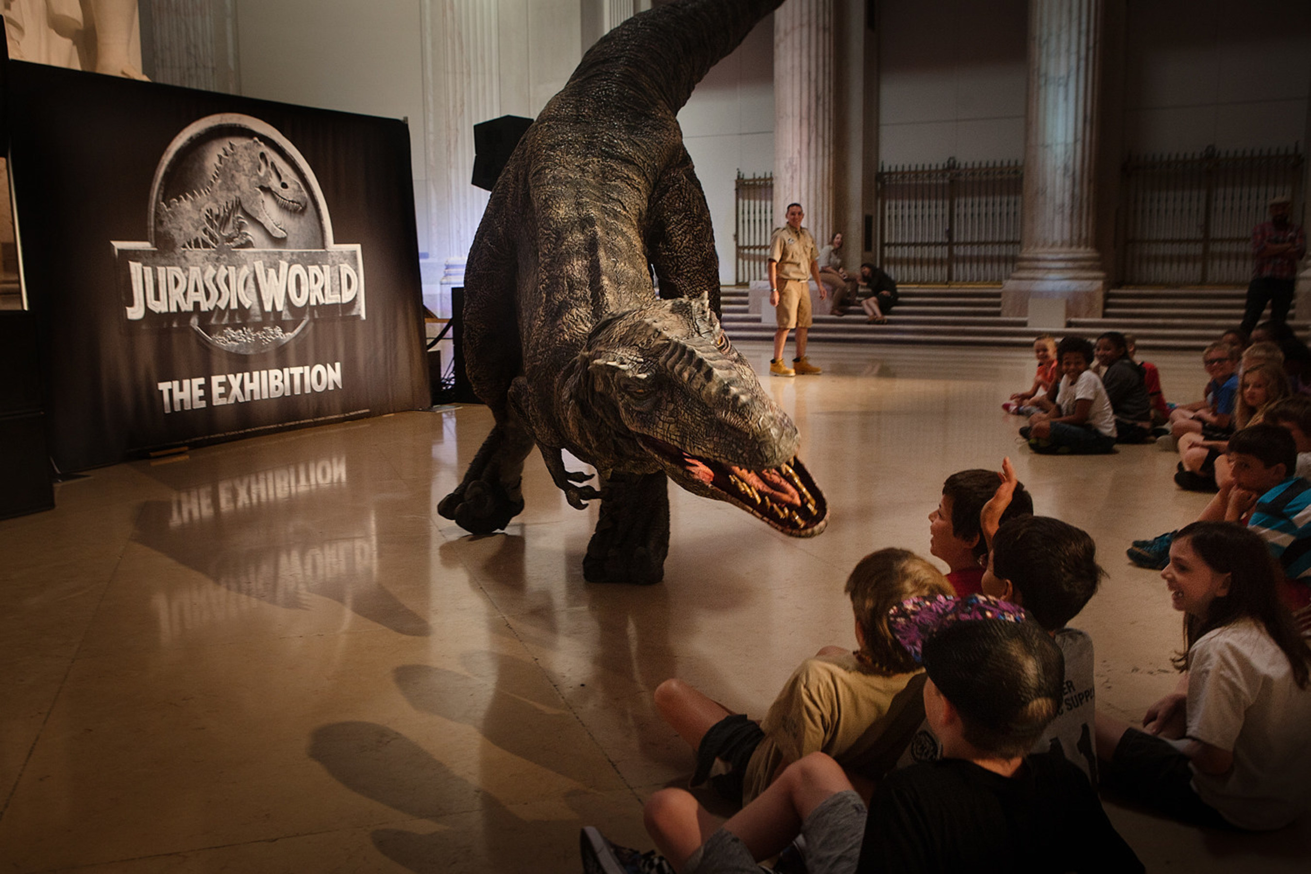 Day campers at Philadelphia's The Franklin Institute were awestruck by the arrival of a live Raptor during NBCUniversal Brand Development and Imagine Exhibitions' announcement unveiling the North American premiere of Jurassic World: The Exhibition. Bringing guests closer than ever before to real-life dinosaurs, Jurassic World: The Exhibition offers a rare look at life-size dinosaurs, set in themed environments inspired by Jurassic World, one of the largest blockbusters in cinematic history. Jurassic World: The Exhibition opens November 25, 2016 at the renowned Franklin Institute. More information can be found at JurassicWorldTheExhibition.com. (Photo courtesy: Daryl Peveto)