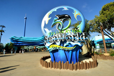SeaWorld's 50th Celebration sculpture lets SeaWorld(R) San Diego guests know they've arrived and that a special celebration is under way. SeaWorld's 50th Celebration, featuring a Sea of Surprises, officially kicks off March 21 and continues for 18 months at all three SeaWorld parks. After guests pass under the 100-foot-long iconic wave at SeaWorld San Diego, they encounter Explorer's Reef(TM), where kids of all ages, and adults, are encouraged to reach in and connect with marine life, including sharks, rays, cleaner fish and more.  (PRNewsFoto/SeaWorld Parks & Entertainment/Mike Aguilera/SeaWorld)