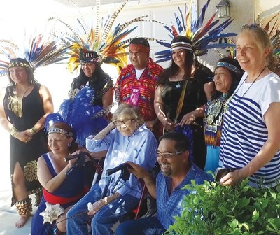 Gloria's hospice care team organized a very special event to honor her love of culture, music, and prayer at her home.