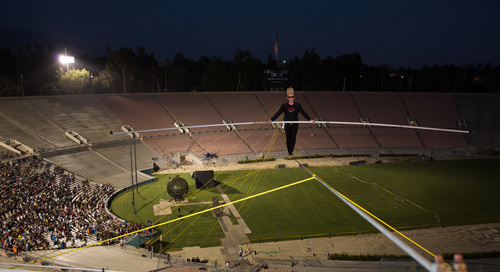 Bello Nock Traverses High Wire High Above Iconic Rose Bowl Stadium (Photo courtesy of Mandt Bros. Productions).  ...