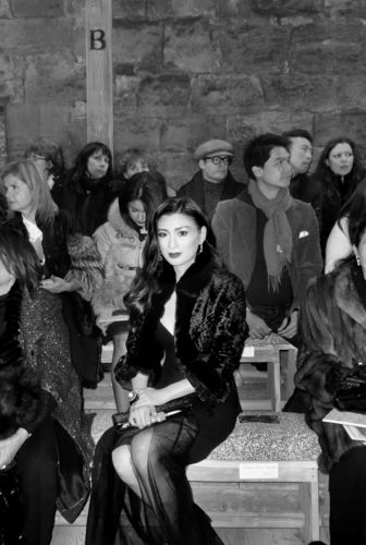 Rebecca Wang attends Chanel's Metiers d'Art fashion show at Linlithgow Palace (Black and White).