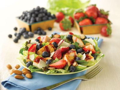 Wendy's Berry Almond Chicken Salad is back by popular demand for the third-consecutive year for a limited time only. Available in two sizes, the salad includes a blend of 11 types of field greens which is topped with blueberries, hand-cut California strawberries, a warm grilled chicken breast, shaved Asiago cheese and California almonds roasted with sea salt.  (PRNewsFoto/The Wendy's Company)