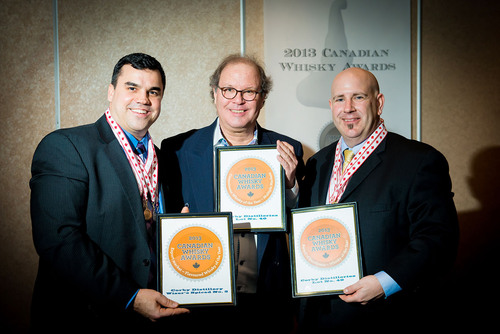 Corby's Lot No. 40 was named Canadian Whisky of the Year at the Canadian Whisky Awards, held January 16 in Victoria BC. David Weaver and Bill Atwood of Corby Distillers accept their award from Davin de Kergommeaux (center), Chairman of the Judges. (PRNewsFoto/Canadian Whisky Awards) (PRNewsFoto/CANADIAN WHISKY AWARDS)