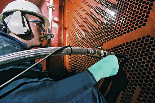 Conco Technician Performing an Eddy Current Test on a Main Steam Condenser (PRNewsFoto/Conco Systems)