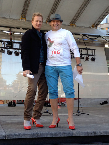 Steve Anthony, Co-host, CP24 Breakfast (left) honours Keith Jasper, Director of Inspiration, Bounce Ideas (right) as the top individual fundraiser at the Walk A Mile in Her Shoes event on September 27, 2012.  (PRNewsFoto/Bounce Ideas)