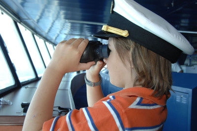 Activities exclusively for junior cruisers include Captain's bridge tours.  (PRNewsFoto/Crystal Cruises)