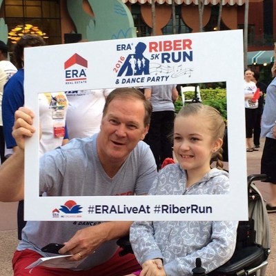 ERA Real Estate president and CEO Charlie Young joins 2015 MDA National Goodwill Ambassador Reagan Imhoff in celebrating the successful ERA Riber Run and Dance Party which raised nearly $25,000 to send 25 children to MDA Summer Camp.