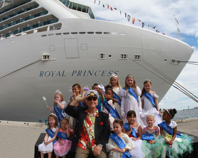 """Love Boat"" Captain Gavin MacLeod is joined by a court of young ""princesses"" who welcomed Royal Princess to Ft. Lauderdale for the first time.  (PRNewsFoto/Princess Cruises)"