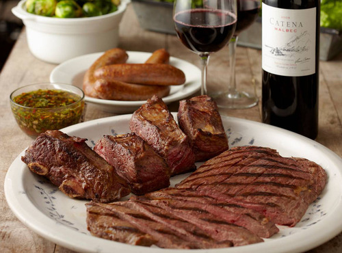For a delicious twist on summer grilling, host an Argentine Asado in your backyard complete with the country's signature wine--Malbec. Just in time for grilling season, Robinson's Prime Reserve is offering six Asado packages each paired with Bodega Catena Zapata's world-renowned wine collection.  (PRNewsFoto/Winebow, Inc.)