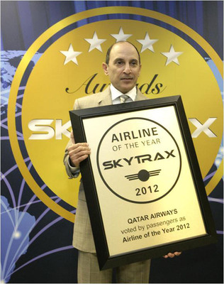 A delighted Akbar Al Baker, Qatar Airways CEO, receives three Skytrax World Airline awards - including the coveted Airline of the Year 2012 - at the annual Farnborough Air Show in the UK.  (PRNewsFoto/Qatar Airways)