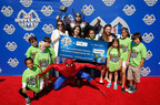 Bett Anderson of REPREVE and Juliette Feld of Feld Entertainment present a check to Brittany Vaughan and the kids of the Boys and Girls Club of America to support recycling education.