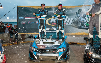 2014 Rally Champions David Higgins and Craig Drew celebrate a commanding win at Ojibwe Forests Rally. (PRNewsFoto/Subaru of America, Inc.)