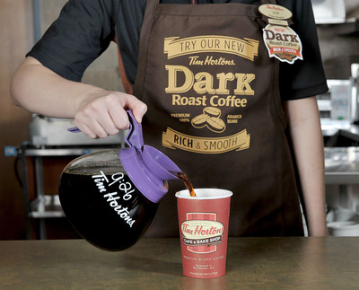 Tim Hortons Cafe & Bake Shop announced today it will pilot a new Dark Roast coffee blend in addition to its Original premium blend. The new Tim Hortons Dark Roast coffee is available at participating Tim Hortons locations in Columbus, Ohio starting today.  (PRNewsFoto/Tim Hortons)