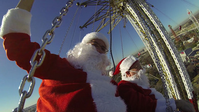 Twenty-four jolly Santas took the ultimate test flight on the Guinness World Record Holder for the tallest swing ride, Texas SkyScreamer, at Six Flags Over Texas. The jaunt was part of a Six Flags Flying Santas Day in conjunction with its sister parks in San Antonio and Vallejo, California. Santas of all shapes and sizes took in the breathtaking view of the Arlington/Dallas/Fort Worth skyline at 400' in the air in celebration of the park's annual Holiday in the Park event.  (PRNewsFoto/Six Flags Entertainment Corporation)