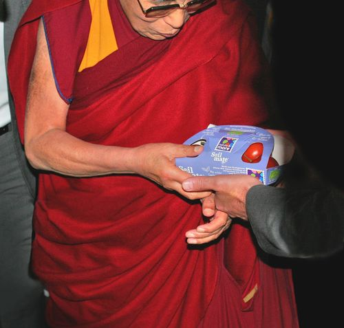 Dalai Lama accepts soilmate from Mr. Engelsman, CEO of Eosta/Nature & More (PRNewsFoto/Eosta)