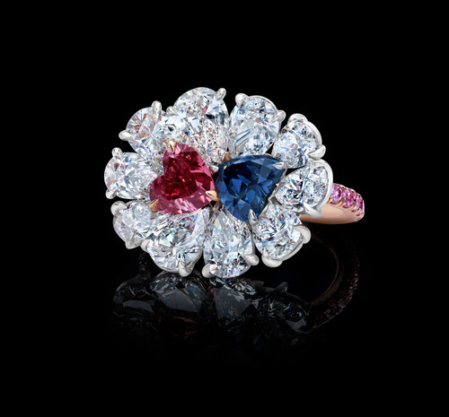 Rare Argyle Red and Bluish Violet Diamond Twin Hearts Ring, featuring a 0.75-carat Natural Fancy Red Diamond and a 0.78-carat Natural Fancy Deep Bluish Violet Diamond (total: 1.53 carats). Available by appointment only. TheOneAndOnlyOne.com.  (PRNewsFoto/The One and Only One)