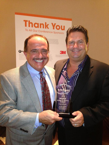 President of Profit On Hold, Otto Mehrgut, accepts Judge's Choice Award from Chairman of the Board, Andy ...