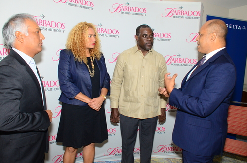 R to L: Richard Pile, District Sales Manager, Delta Air Lines, chats with Barbados Tourism Authority's (BTA) Chairman, Adrian Elcock; BTA's Interim President and CEO, Petra Roach; and Barbados Hotel & Tourism Association's (BHTA) President, Sunil Chatrani after the just concluded press conference launching the recommencement of a Delta Air Lines' Barbados service. (PRNewsFoto/Barbados Tourism Authority)