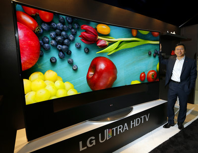 William Cho, president of LG Electronics USA, unveils LG's 105-inch Ultra HD 4K TV (model 105UC9) at the CEDIA Expo 2014. (PRNewsFoto/LG Electronics USA, Inc.)